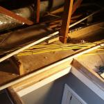The yellow cables should be at least six feet from the side of the attic scuttle hole in all directions if installed this way. Code allows exceptions to this, but they are labor intensive.