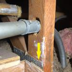 Someone drilled a hole through the upright of this truss to install a conduit for some electrical circuits. The steel web, (yellow arrow) indicates this is a 'truss', and not a conventional framing member. Trusses are engineered for a specific load capability and shall NEVER be altered in any way.