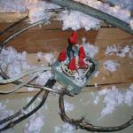 This open junction box was found under some blown in insultion. These 120 volt connections can and sometimes do spark and cause fires. Also some of the cables are old and frayed.